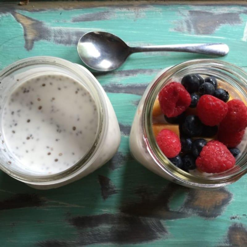almond milk yogurt with strawberries and blue berries in mason jar