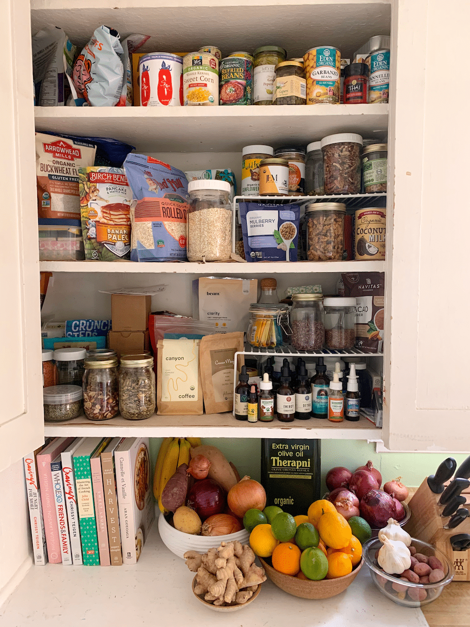 stocked pantry full of healthy food from the grocery store