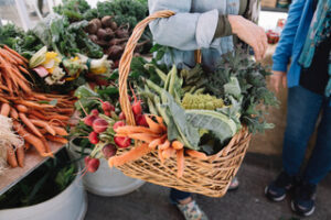 fresh organic produce from the farmers marketin with carrots and kale