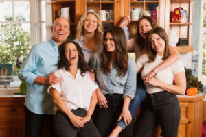 curry family smiling enjoying themselves in kitchen in front of counter